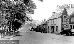 Bamburgh, The Castle And Village 1954
