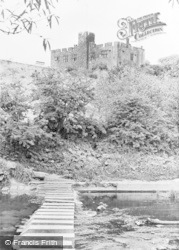 Bothal, The Stepping Stones And Castle c.1955
