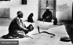 A Snake Charmer c.1935, Cairo