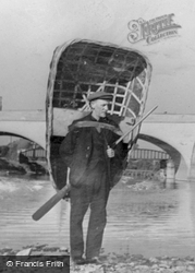 Carmarthen, Man Carrying A Coracle c.1950