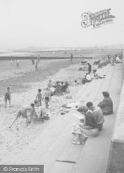 Chapel St Leonards, Beach, Reading The Paper c.1955