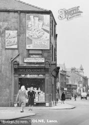 Colne, Advertising Hoarding c.1950