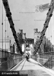 Conwy, Crossing The Suspension Bridge c.1910