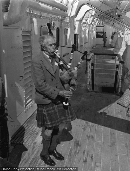 Photo of Iona, Playing The Bagpipes c.1955