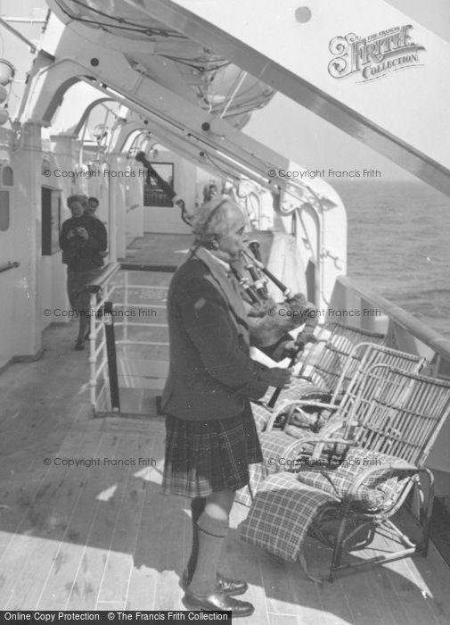 Photo of Iona, Seton Gordon Playing The Bagpipes c.1955