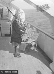 Iona, Seton Gordon Playing The Bagpipes c.1955