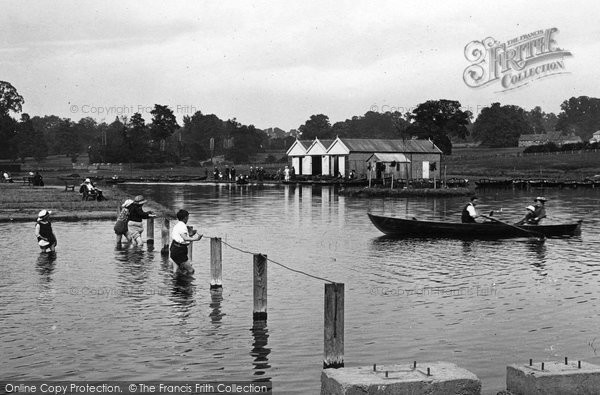 Playing in The Lake, Wicksteed Park 1922, Kettering. The Frith logo will not