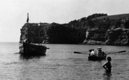 Ladram Bay, A Bather And Rowing Boat c.1955