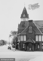 Loughton, Chemists, And Lopping Hall Clock Tower c.1955