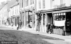 Okehampton, Fore Street, Man On Ladder 1890