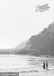 Oxwich, A Couple Walking On The Beach c.1960