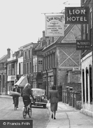Passing By The Lion Hotel, High Street c.1955, Ramsey