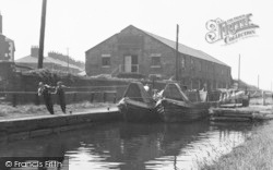 Runcorn, Men Pulling Canal Boats Through A Lock c.1955