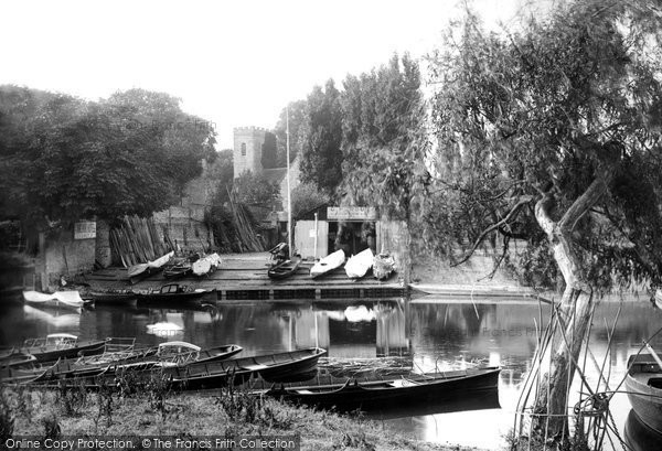 Shepperton, boatyard with punts and church in the distance, 1890. Reproduced courtesy of The Francis Frith Collection