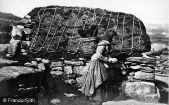 Shetland, Island Woman carrying peat c1890