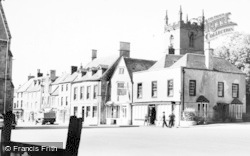 Stow-on-The-Wold, The Stocks And St Edward's Church c.1955