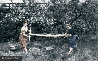 Strathpeffer, Highland Girls wringing the washing c1890