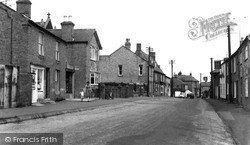 Sutton, Post Office And High Street c.1960