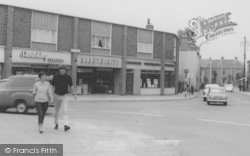 Wigston, A Couple In The Town Centre c.1965