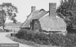 Man Inspecting Roof c.1950, Wimbish
